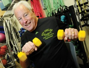 Barrie Chapman of Fit Fellas demonstrates an exercise using weights
